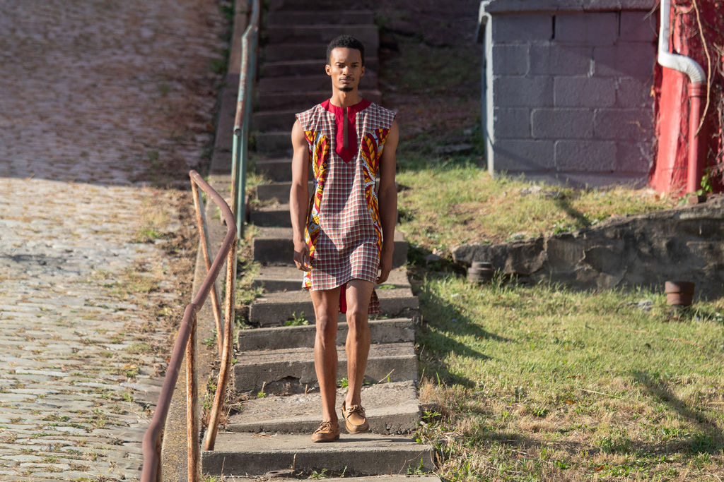 Jake Clark in a plaid and African Wax print tunic