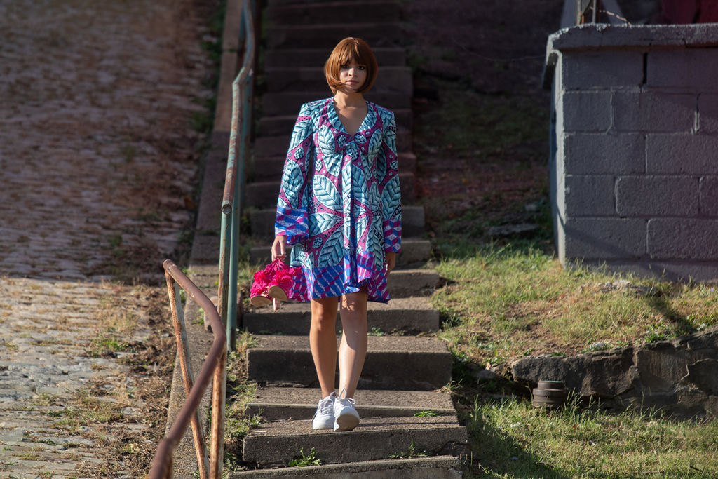 Marlissa Miller in a blue and pink bell sleeve baby doll dress